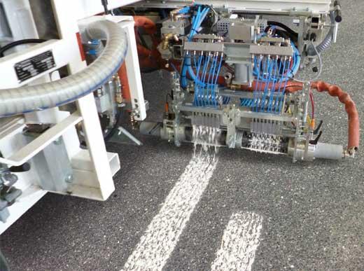 Enduits à froid 2c: Marquage d'aggloméré à structure irrégulière avec système de pompe de soufflet