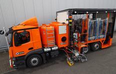 H37-5000P camión de multiuso con depósitos sin presión intercambiables (4 x 1250 l) para pinturas en frío 1 componente con bomba y plásticos en frío de 2-componentes pulverizables para el modo Airless con bomba dosificadora trabajando dependiente del tray