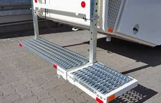 Laterally pluggable additional rear platform for series H26/H33