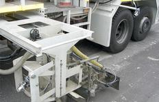 Two-sided camerasystem with pneumatic device to prevent lense clouding and blurring, for example mounted at a roadmarking truck with sprayable thermoplastics equipment for ensuring accurate marking application, i.e. correct line beginnings and endings